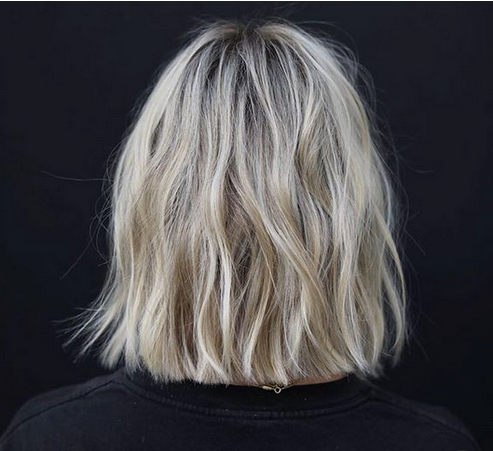 Light blonde layered medium hair