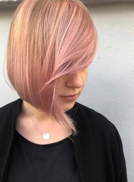Short pink pastel side fringe bang hair by Christian Cartano