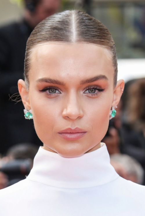Josephine Skriver clean slick up do center part hairstyle at Cannes Film Festival 2019