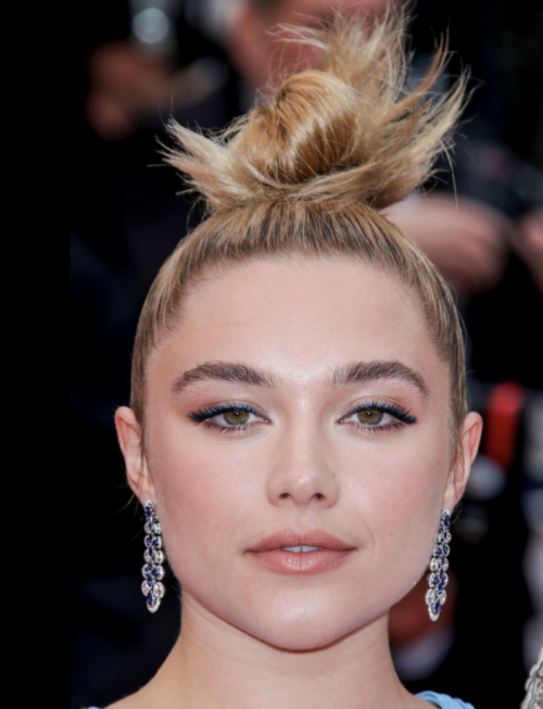 Florence Pugh top knot up do hairstyle at Cannes Film Festival 2019