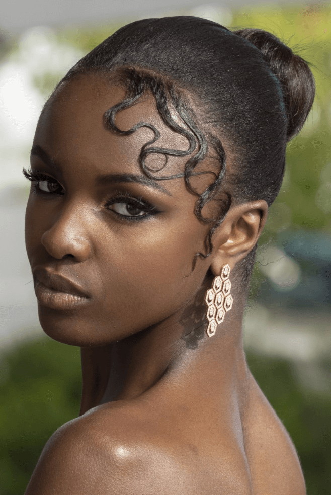 Leomie Anderson lace up do hairstyle at Cannes Film Festival 2019