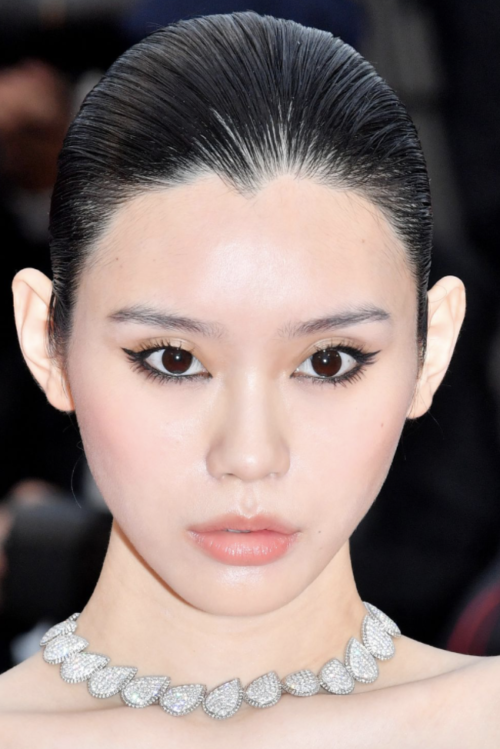 Ming Xi Wet hair slick back up do hairstyle at Cannes Film Festival 2019