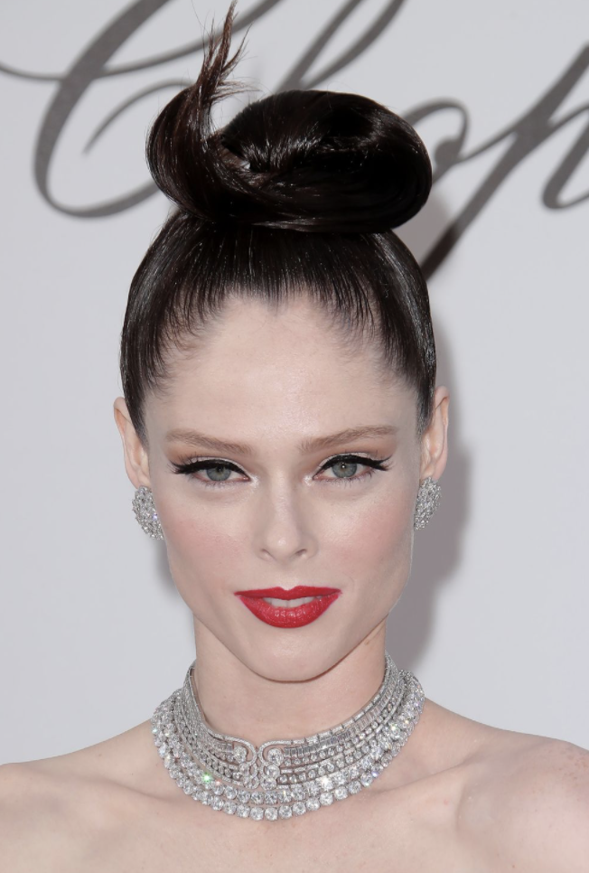 Coco Rocher top knot up do hairstyle at Cannes Film Festival 2019